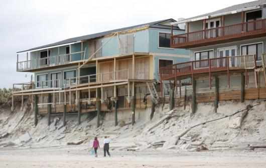 Condemned homes along the heavily eroded shoreline at Vilando Beach in Florida