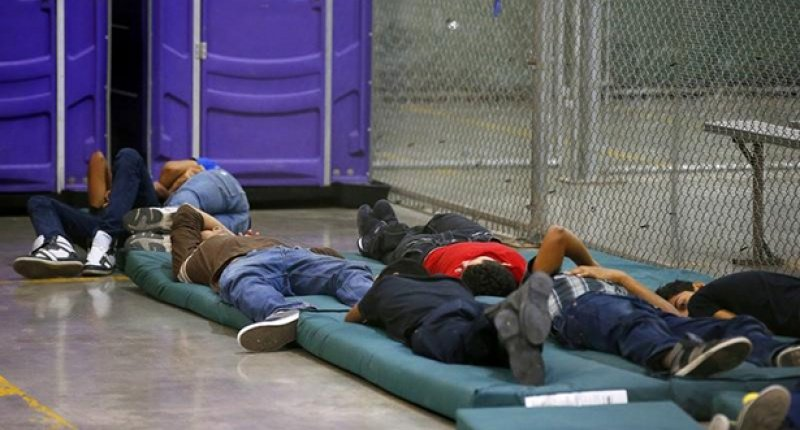 Young-boys-sleep-in-a-holding-cell-where-hundreds-of-mostly-Central-American-immigrant-children-are-being-processed-800x430