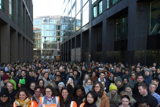 Workers stand outside the Google offices after walking out as part of a global protest over workplace issues in Dublin
